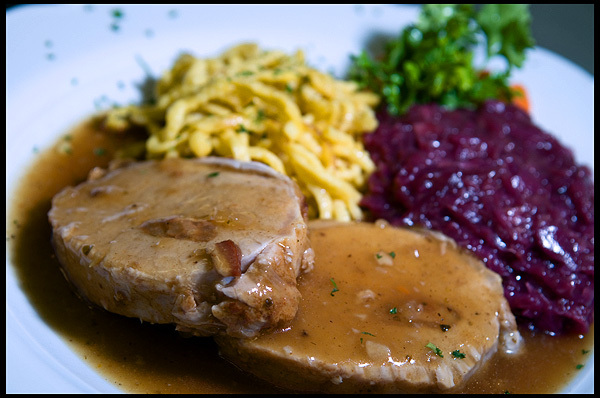 Pork Loin stuffed with Onion, Bacon, Herbs and Garlic, slowly oven-roasted and served with Spatzle and Red Cabbage.