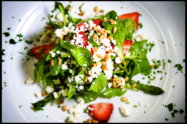 Arugula, fresh Strawberries  and Green Asparagus tossed in a  White Balsamic Vinaigrette topped  with toasted Pine Nuts and Feta Cheese Crumbles
